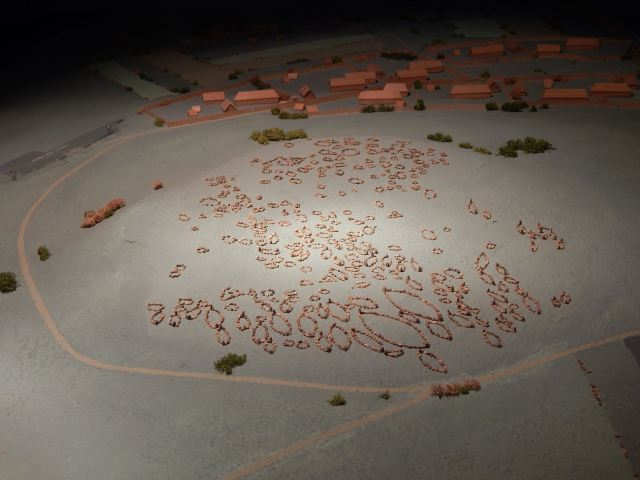A model of the Lindholm Høje cemetery and an adjacent settlement, as they may have looked during the early Viking Age, ca. 800.